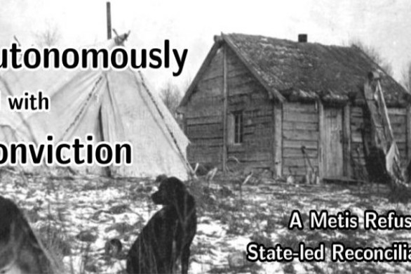 A cabin, built from slats of wood sits in sod covered with a light dusting of snow. A canvas tent is erected next to it and two dogs sit in the foreground, one sniffing the ground and the other observing this dog. A sled rests against the cabin.